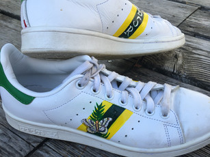 Stan Smith sneakers painted with initials, stripes, butterflies and ferns