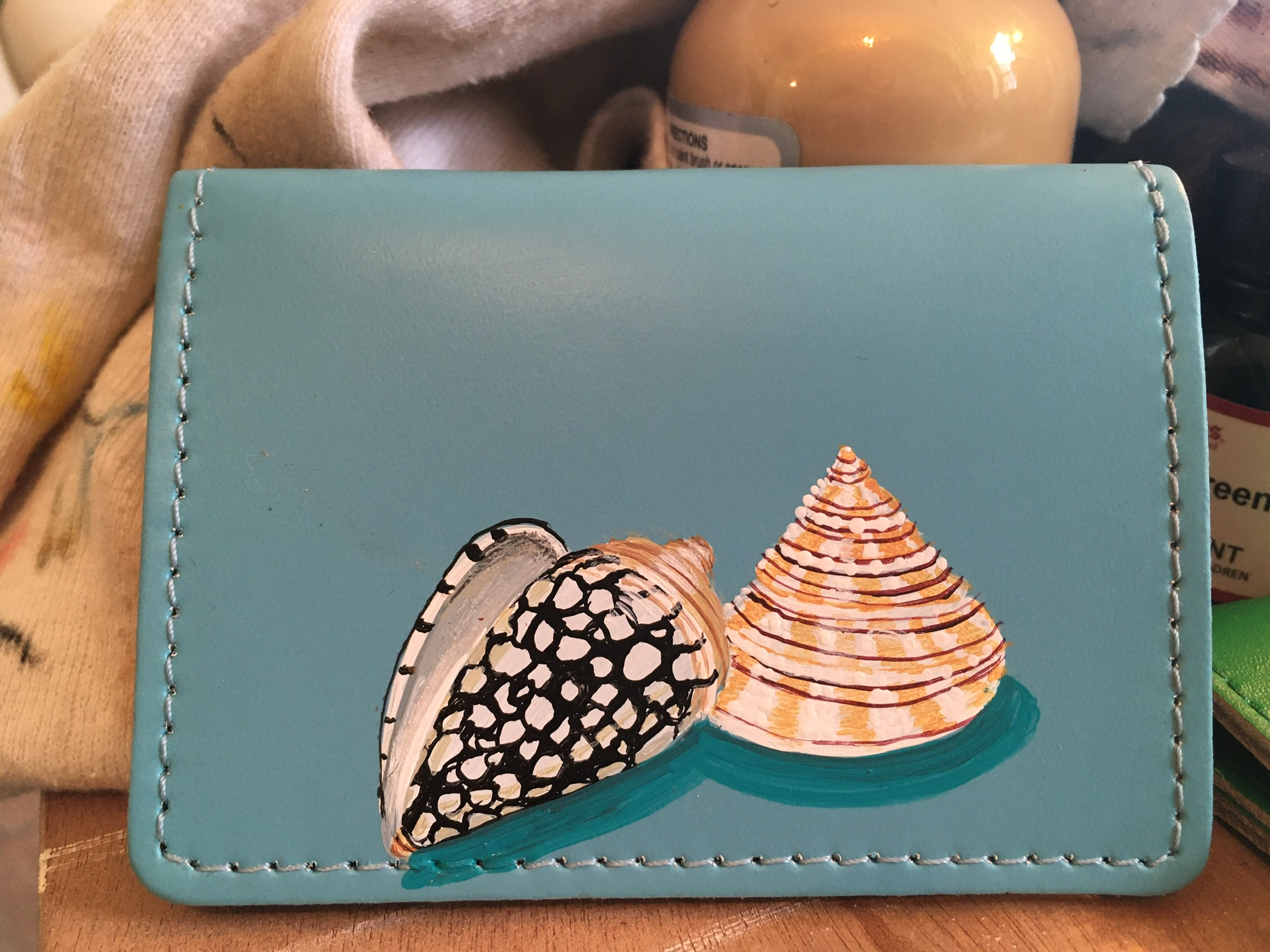 leather card case painted with shells