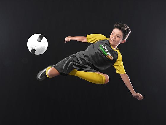 custom-soccer-jerseys-boy-doing-a-scissor-side-kick-a16605.png
