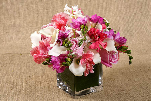 White Mini Calla Lilies Hyacinth Red Sweet Peas And Shocking Pink Roses In A Gl Cube Vase This Is Scented Arrangement