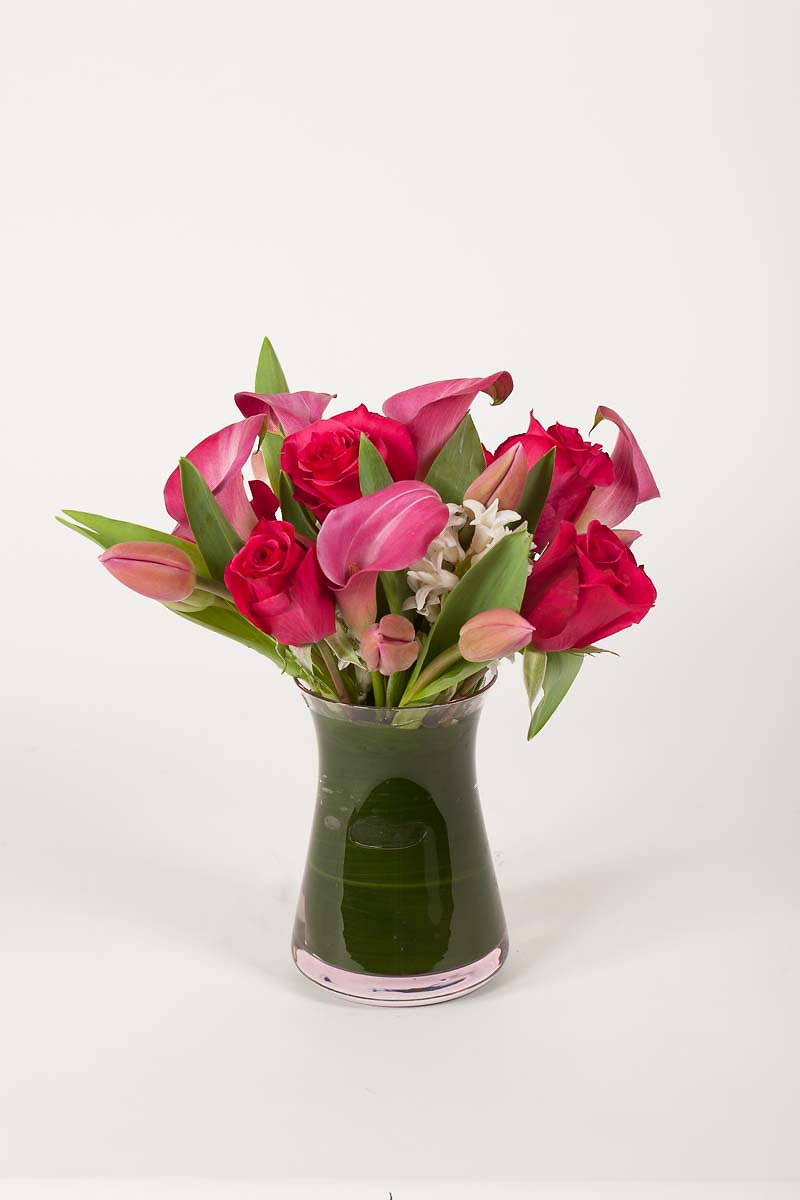 Flowers by special arrangement roses tulips calla lilies pink roses tulips and calla lilies in a glass vase with a leaf insert all everyday arrangements come medium size and medium height reviewsmspy