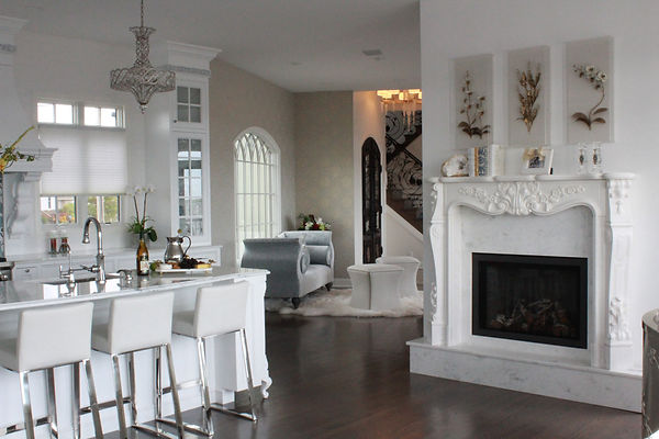 White coastal kitchen with marble fieplace