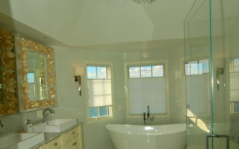 Coastal Bathroom with High Ceiling