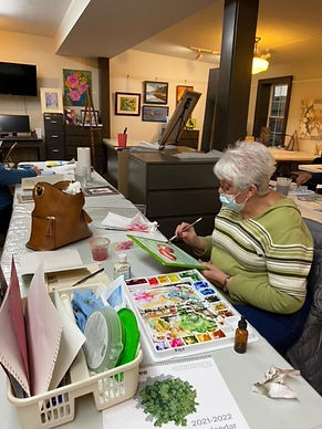 Carolyn completes her watercolor poppies