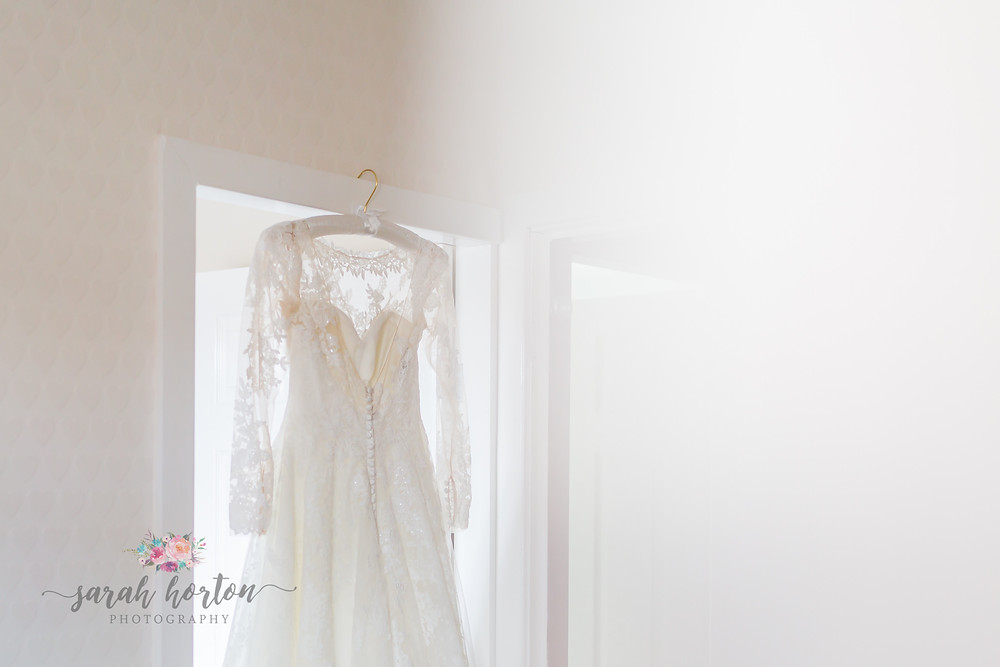 Chester wedding photography dress hanging in bridal prep