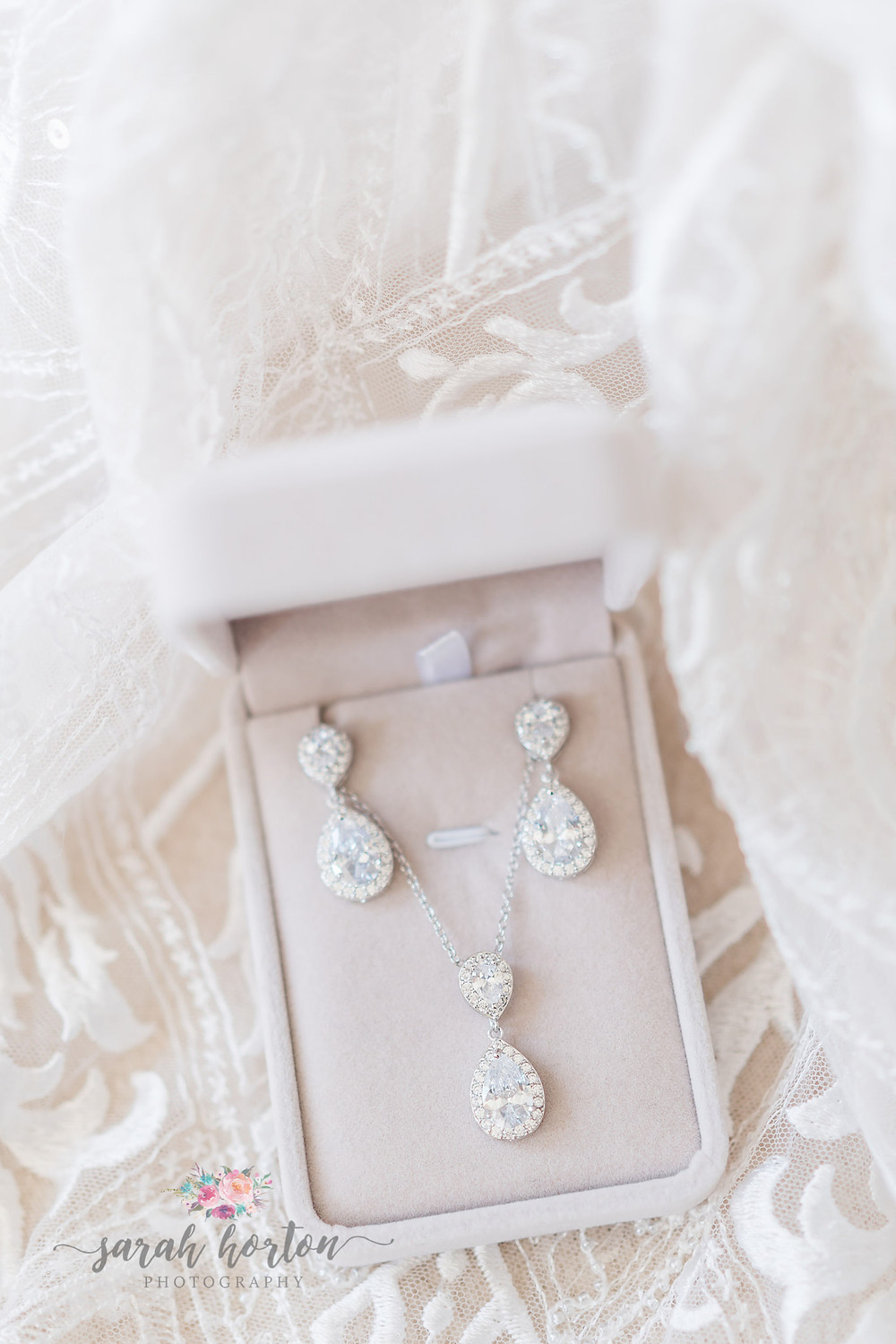 diamond earrings surrounded by lace