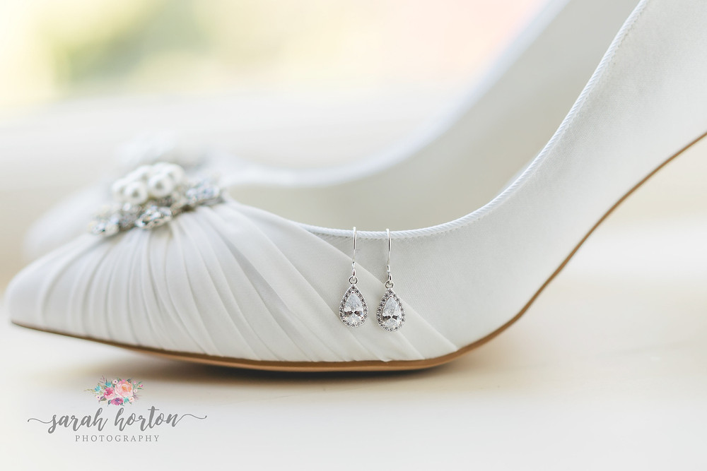 diamond earrings on bridal shoes