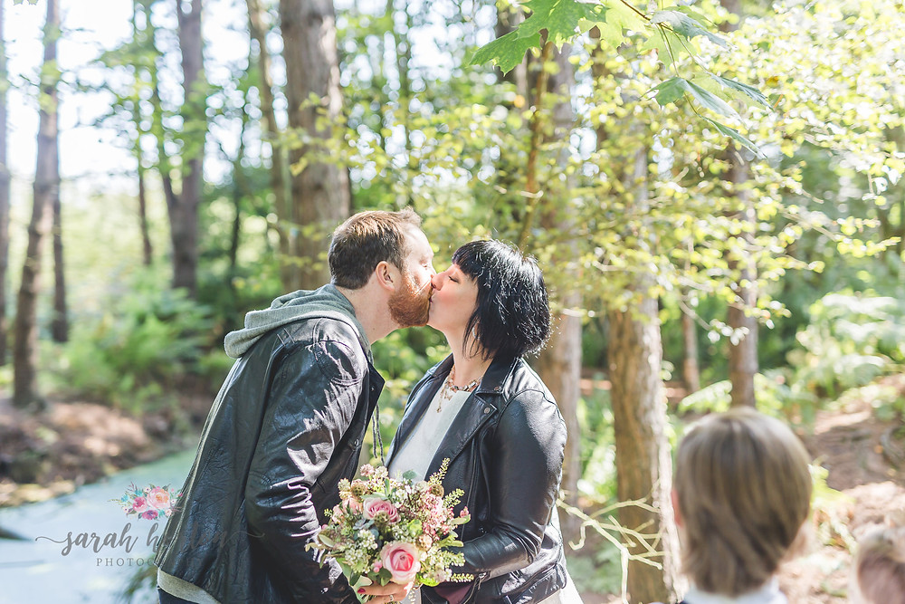 vow renewal kiss in the forest
