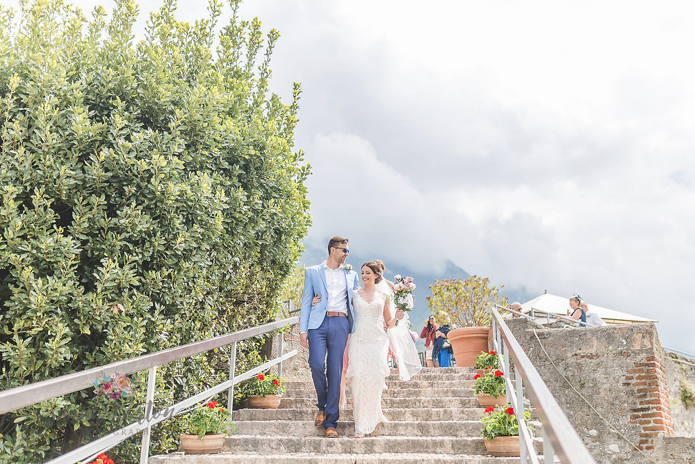wedding party walk down cobbled steps at malcesine castle, lake garda