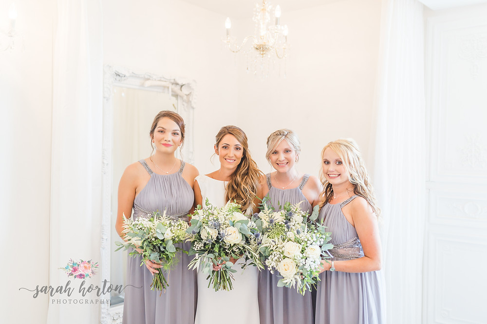 bridesmaids with flowers at alcumlow barn