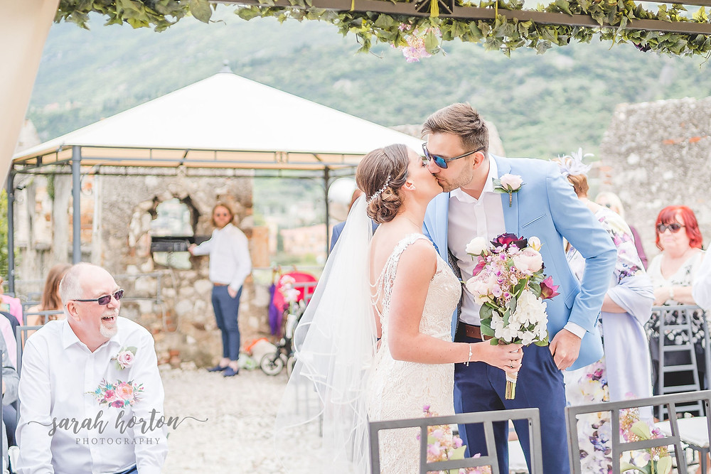 bride and groom at malcesine castle wedding, lake garda