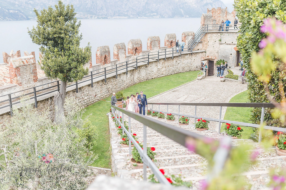 bridal party walk up steps at malcesine castle wedding