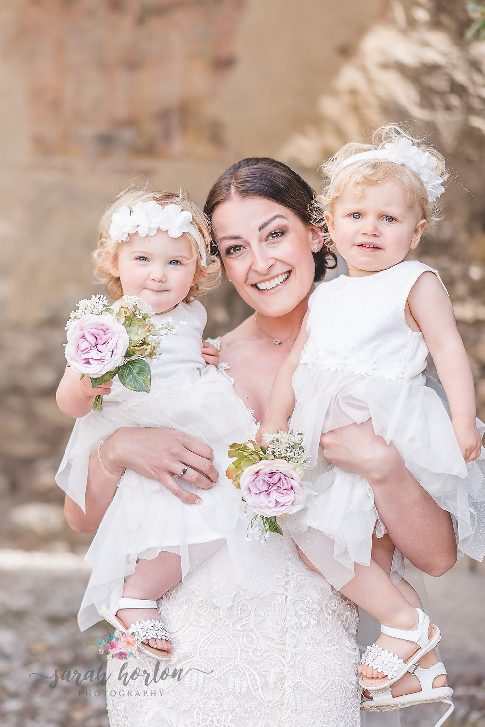 bride and smiling flower girls at malcesine castle