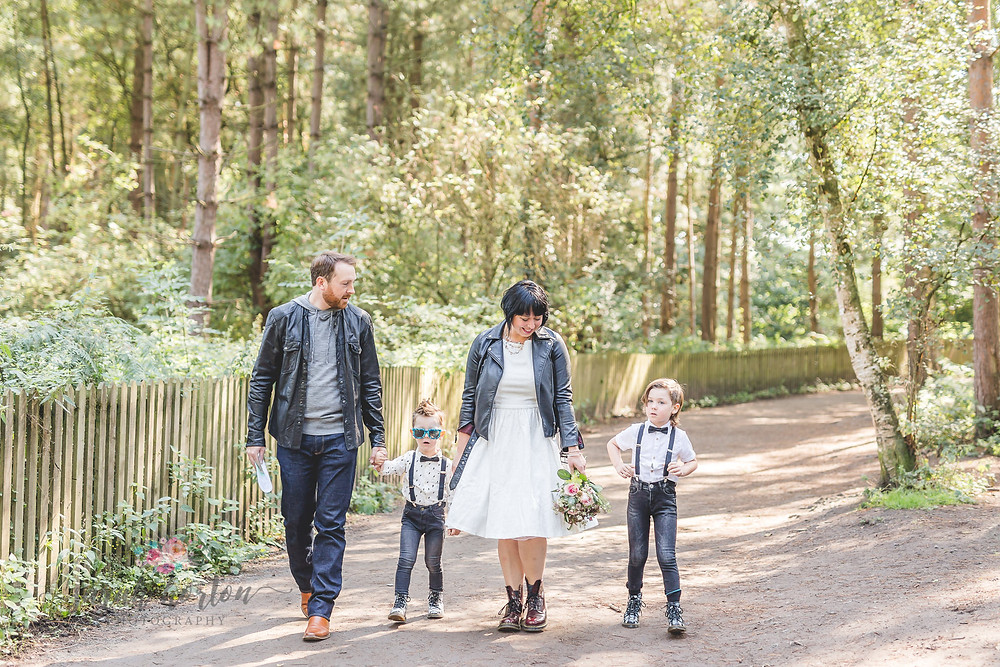 Family walk through Delamere heading to vow renewal in Doc Martens