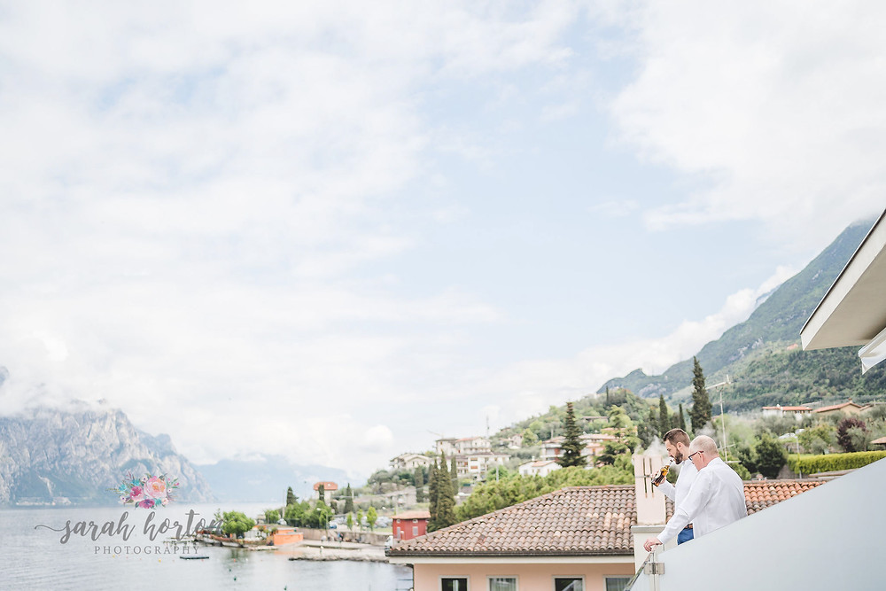 groomsmen look out over lake garda in malcesine