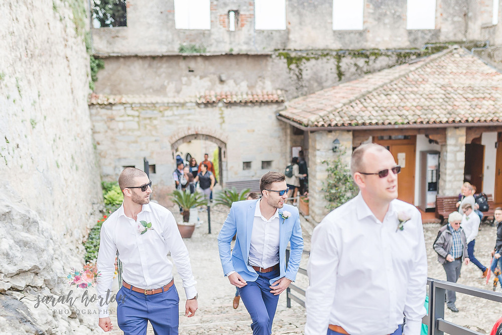 groom heads up steps at malcesine castle wedding