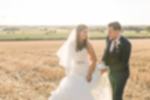 Couple kiss at Alcumlow Hall Farm Wedding Barn