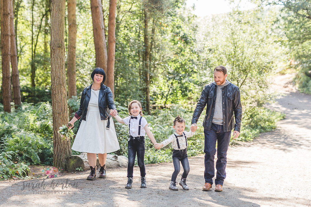 family in forest with doc Martens and flowers
