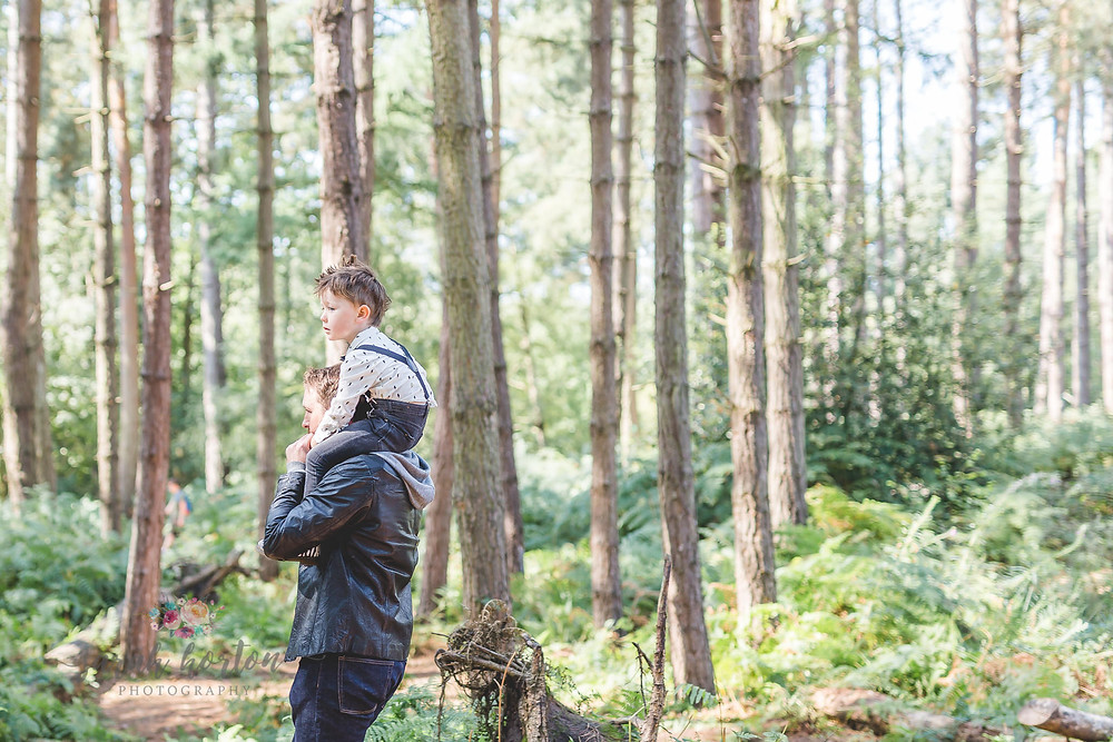 father and son piggy back ride in delamere forest