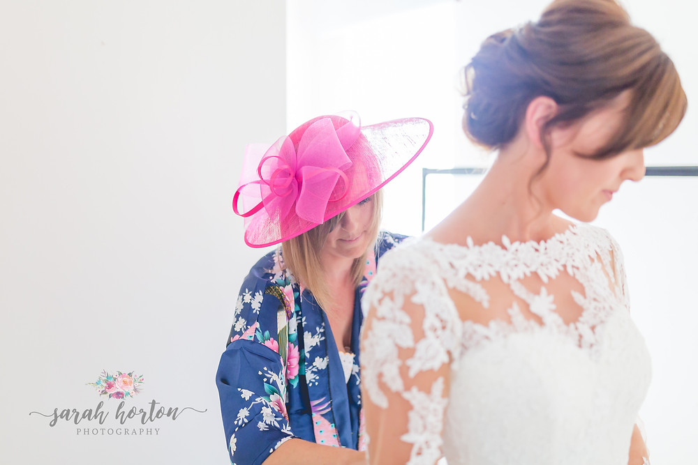 bridal prep in light airy room by cheshire wedding photographer