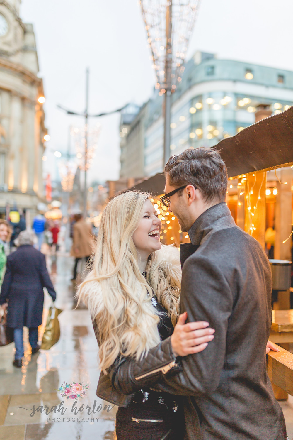 couple laugh in manchester street pre wedding photography