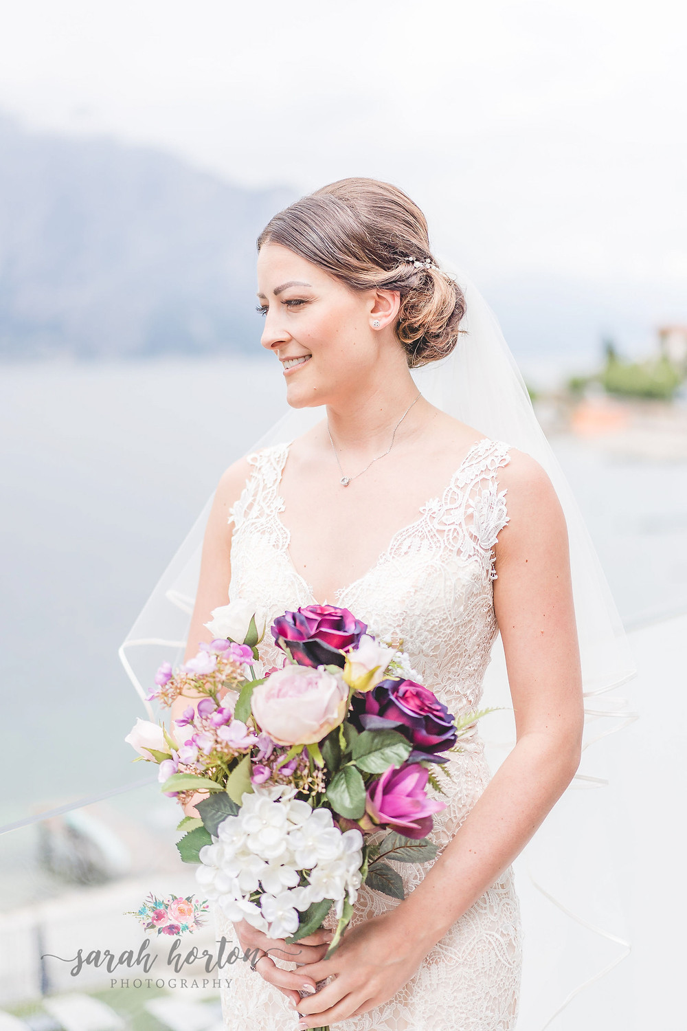 bride looks out over lake garda