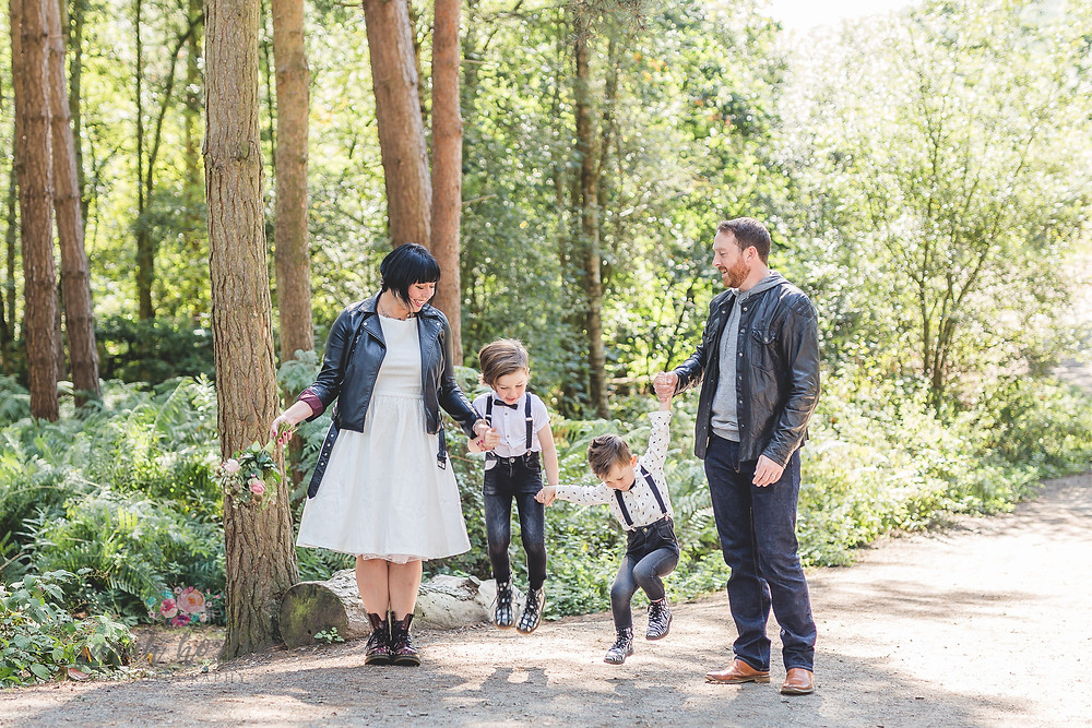 children jump after vow renewal in doc Martens