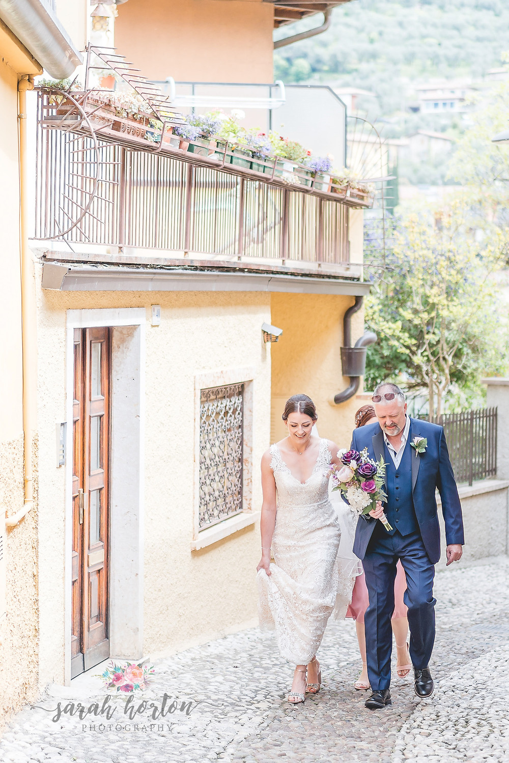 malcesine wedding photography bride walks with dad