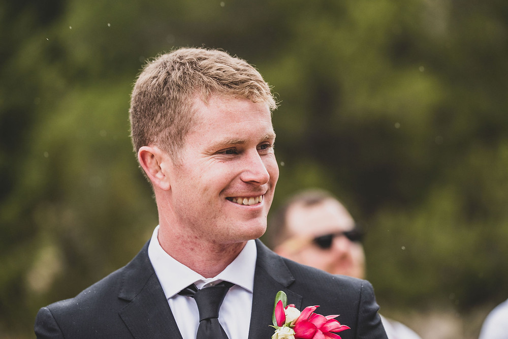Groom sees Bride at aisle reaction