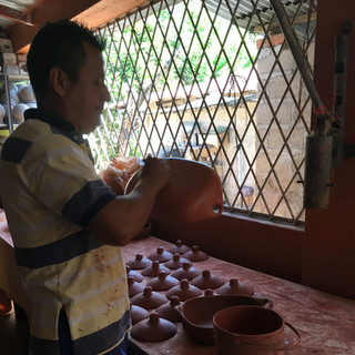 red clay is applied with a brush