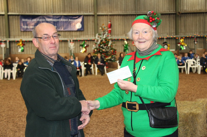 Our Own Christmas Pixie, Jean Bedford receiving cheque from the Aesopian Golf So