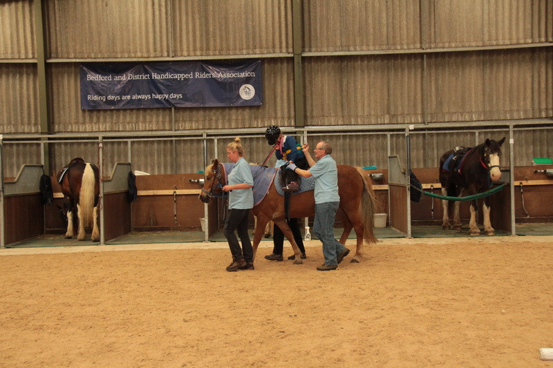 Candy (2) being riden by Carys Ayling, Helpers Becky Bullough (leading, Janet Tr
