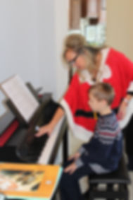 Lana giving private piano lessons to a student from Delray Beach. Christmas Piano Songs being taught.
