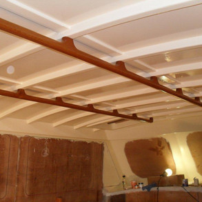 The visible structural timbers throughout the interior and the struggle over spray or brushed paintwork which was won by the brush keep a 'this is a timber boat' feel even though painted surfaces will be throughout with only highlights of clear timber.