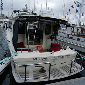 Stern view of Mutual Attraction showing off her stern and excellent stainless steel fabrications