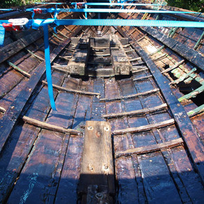 Bote Cote Epoxy Resin System applied to internal timbers and under ribs still in place. Note Straps still holding hull in place