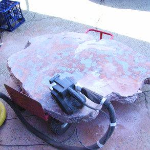 Coarse sand 40 to 60 grit both faces using a belt sander or random orbital sander to remove lumps & bumps and all gloss