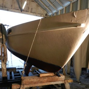 Showing bow area with undercoat awaiting sanding.
