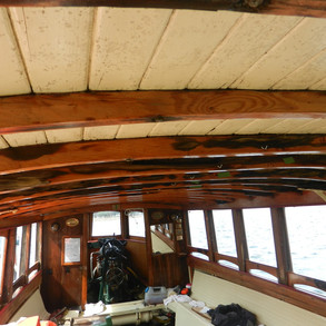 Loose Deckhead timbers due to rot in beams. This is due to moisture seeping down throug nails.