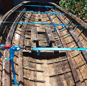 Straps on hull and broken ribs removed to clean out all old paint and to check for any hidden damage
