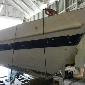 Hull partly sanded back starboard side. Note: Hole at Bow.