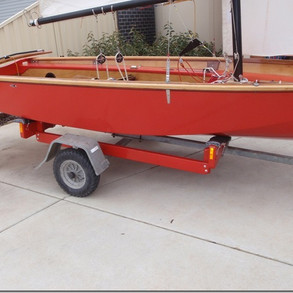 Hull from starboard side showing off red Aquacote finish