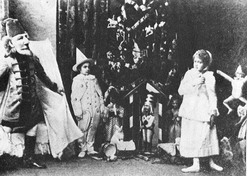 Nutcracker_-Scene_from_Act_I_-Sergei_Legat_as_Nutcracker,_Stanislava_Stanislavovna_Belinskaya_as_Clara,_&_Unidentified_as_a_Gingerbread_Soldier_-1892