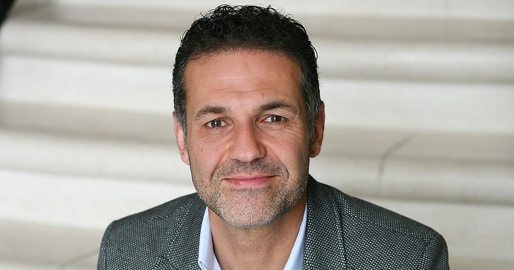 Khaled Hosseini fuller shot publicity photo (c) 2013 by Elena Seibert