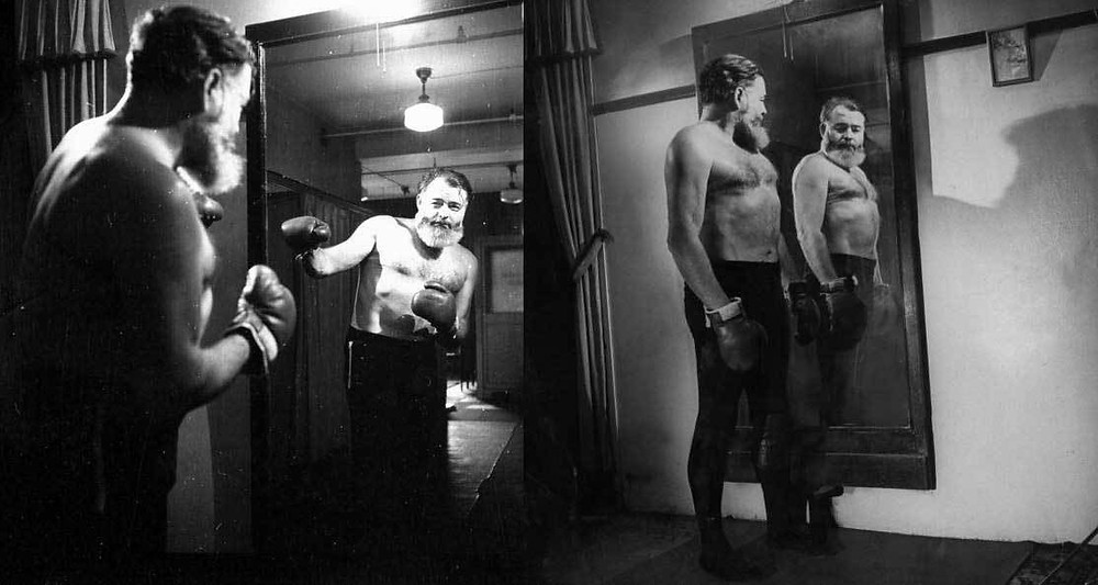 Ernest-Hemingway-practicing-his-boxing-in-front-of-a-mirror-1944