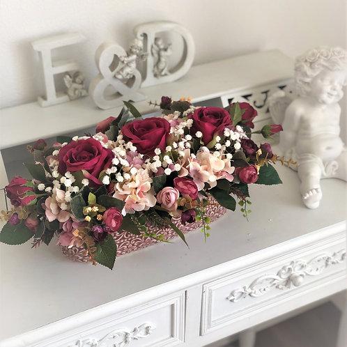 Künstliches Blumenarrangement in einer Vase Oval