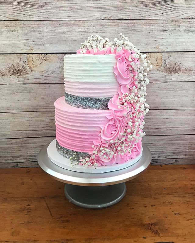 Two tiers of vanilla cake flavoured with