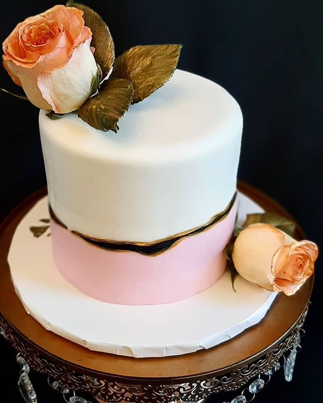 Marbled pink, black and white fondant wi