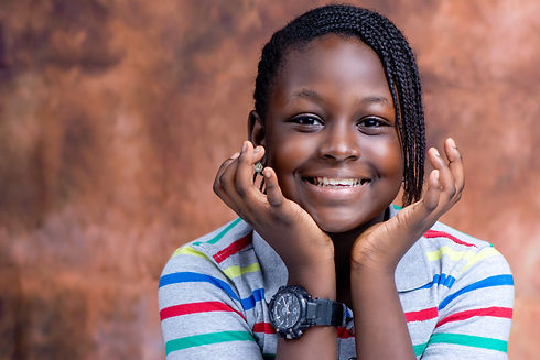 Head shot of smiling Nigerian girl with