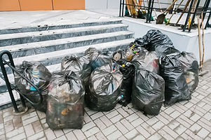 Garbage bags on the sidewalk, the work o